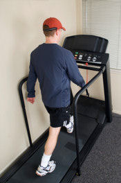 man doing walking exercise on a treadmill